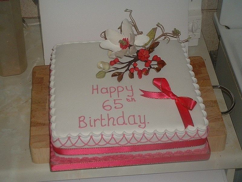 Square 65th Birthday Cake With Handmade Flower Decoration