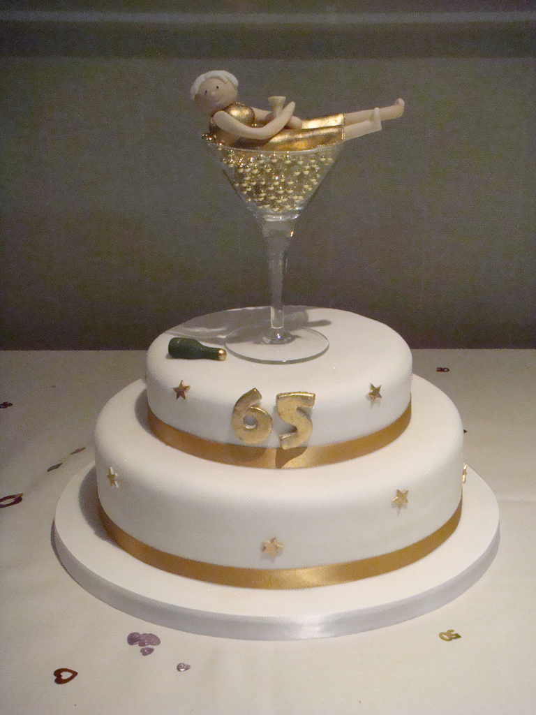2 Tiier 65th Birthday Cake With Champagne Glass Topper